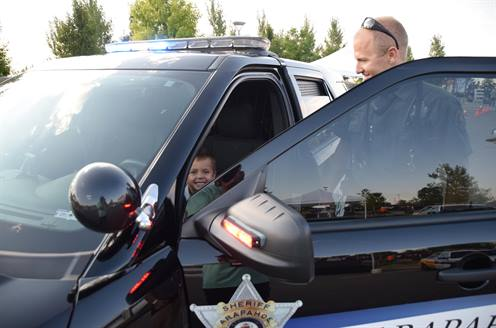 image of kid in police car