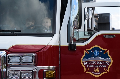 image of boys in fire truck